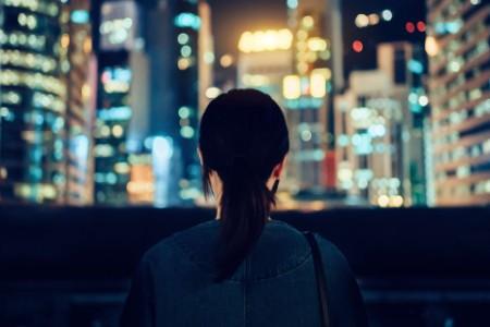 Woman looking at a city