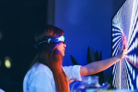 Woman wearing augmented reality glasses touching screen