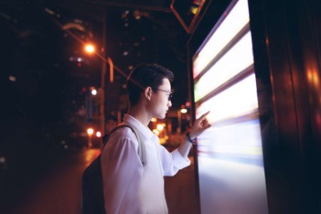 Woman looking outside through a window