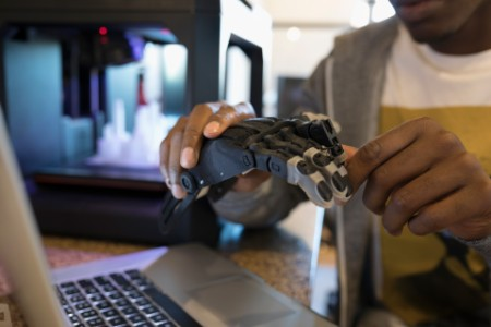 man playing with robotic arm