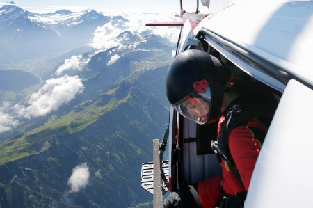 Helicopter pilot looking down over mountainous terrain
