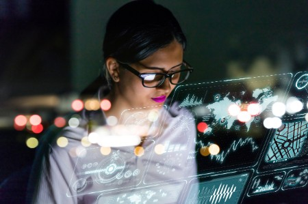 Woman engineer looking at illuminated screen