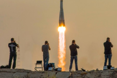 Photographers watch the Soyuz spacecraft launch from the Baikonur