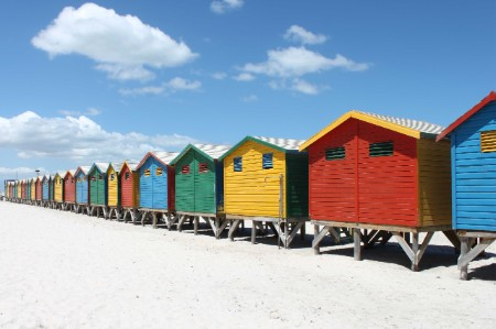 brightly painted beach bathing huts at false bay muizenburg cape town south arica