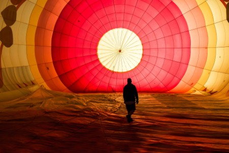 Man walk balloon sunrise