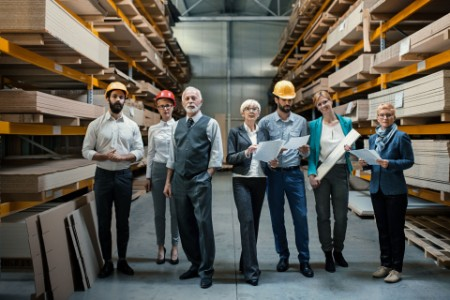 family business owners standing in their factory metadata image