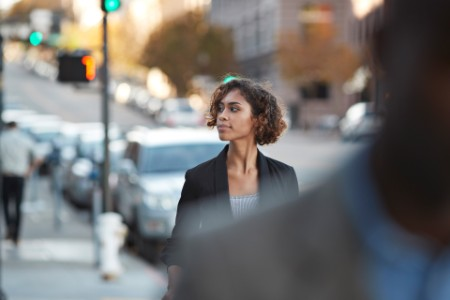 businesspeople walking in pedestrian crossing