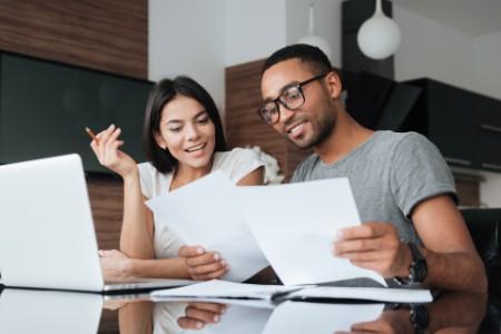 couple using laptop analyzing finances