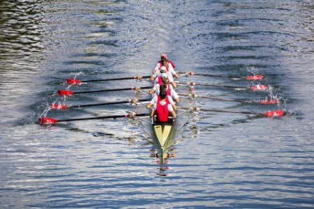 Eight man rowing team on the water