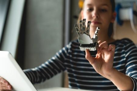 girl working with robotic hand