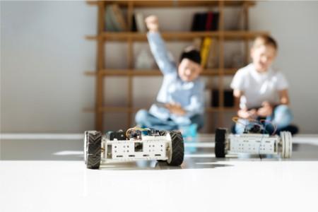 boys celebrating victory in car race