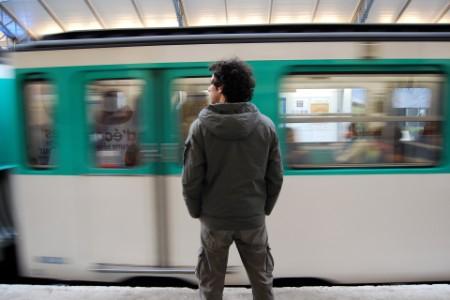 Man standing near moving train