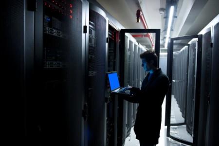 Programmer laptop server room working