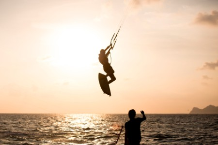 rear view silhouette man kite surfer above sea sunset