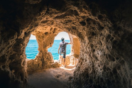 Man inside hollow cave