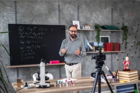 Photographer recording video of teacher during online class
