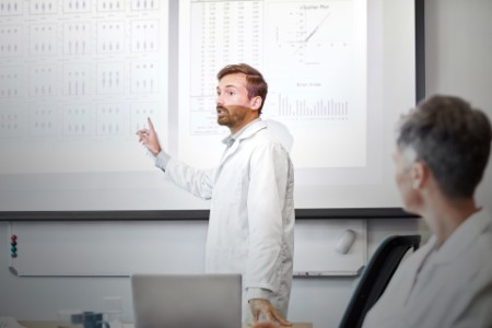 Scientist giving presentation over treatment