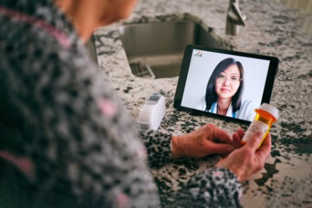 Senior woman on a virtual doctor visit