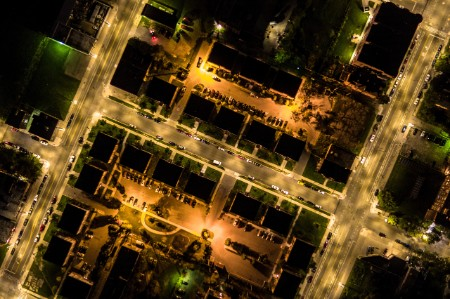 A night time aerial shot of Detroit's city streets showing the street lighting.