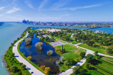 A wide shot showing Belle Isle state park with the city of Detroit in the background