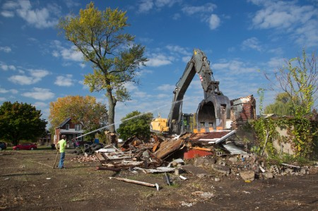 A deserted house is demolished in Detroit