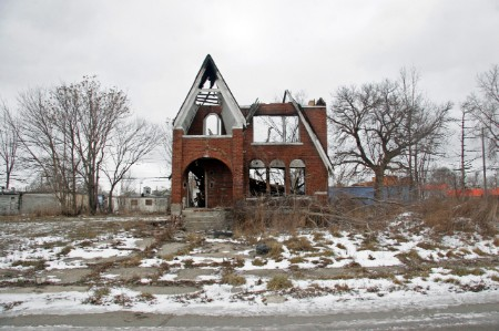 A burnt out house in a deserted Detroit neighborhood