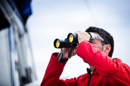 sailor with binoculars in red jacket
