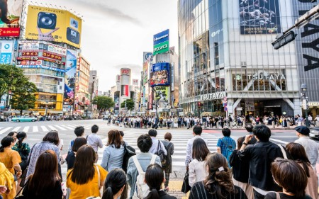 Busy pedestrians at famous Shibuya Crossing, Tokyo, Japan.