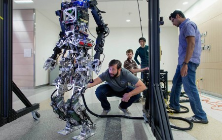 Man checking walking robot