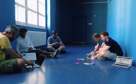 People sitting on a floor in a blue room