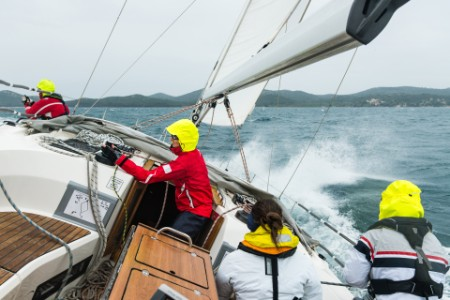 The sailing course crew on the rippled sea photo
