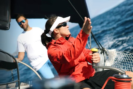 female sailboat captain in red jacket