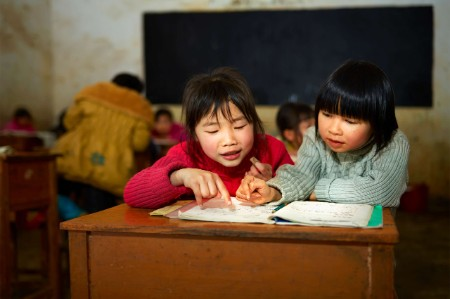 school children studying book