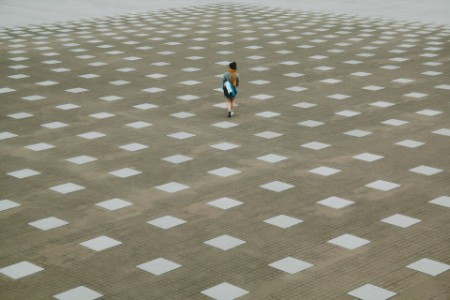 Woman walking tiled floor Japan