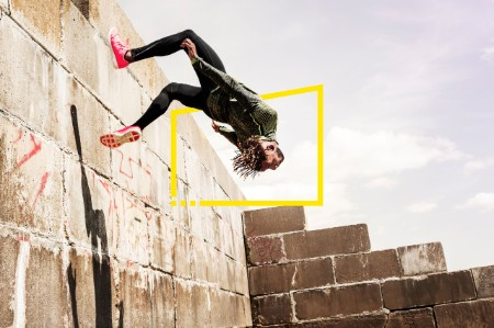 young man somersaulting side wall