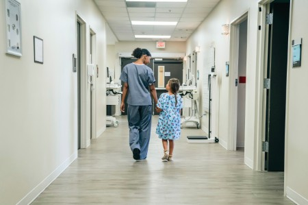 nurse walking girl hospital corridor