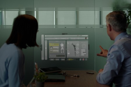 Man and woman looking in to smart display devices