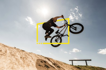 bmx cyclist jumping against sky