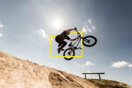 bmx cyclist jumping against sky