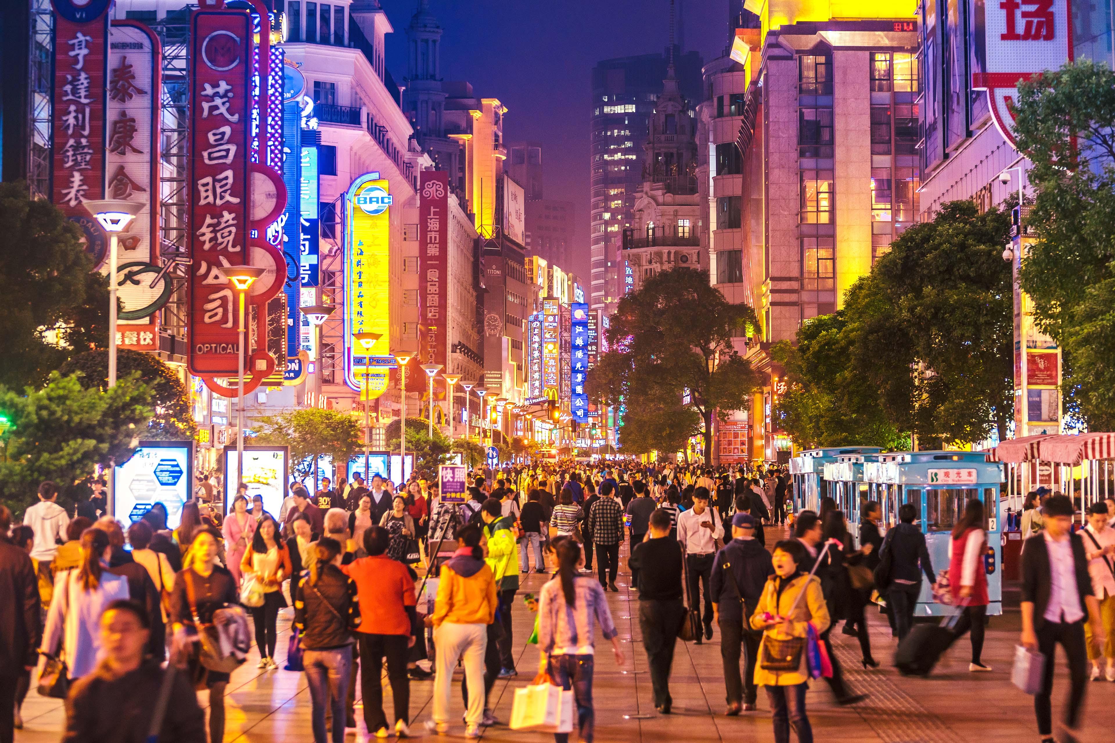 Crowds walk Nanjing Road