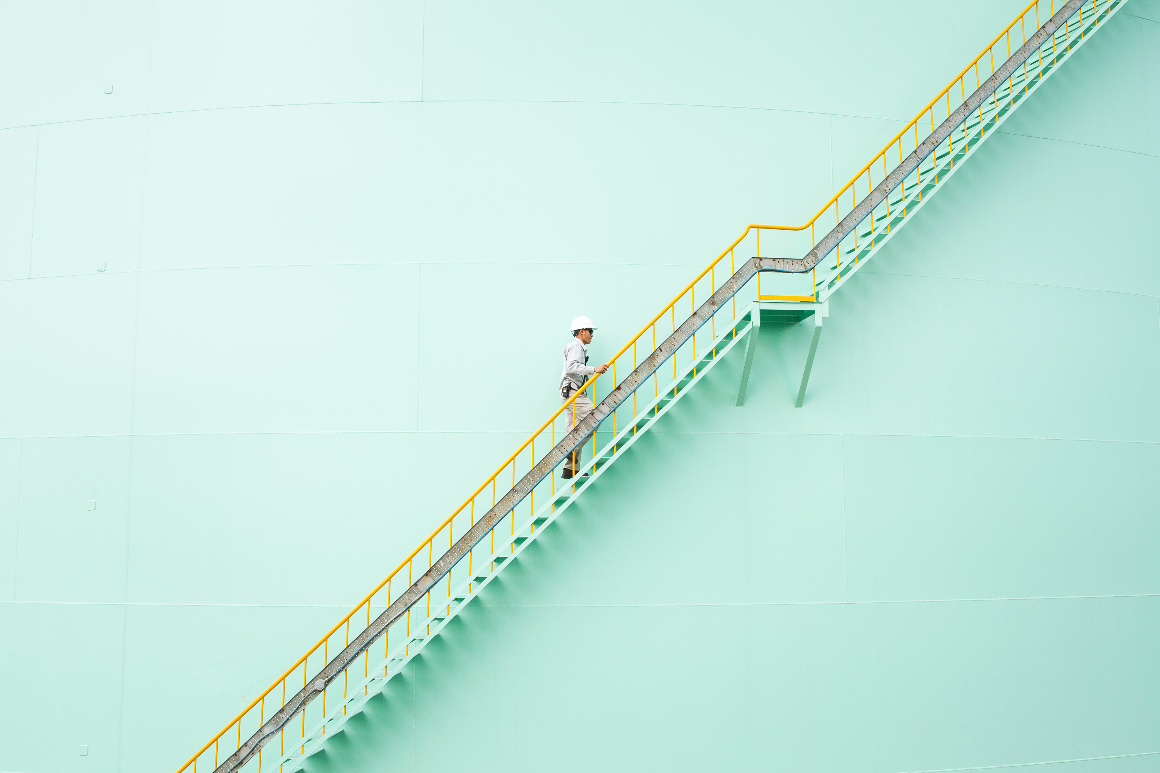 Man ascending steep stairs