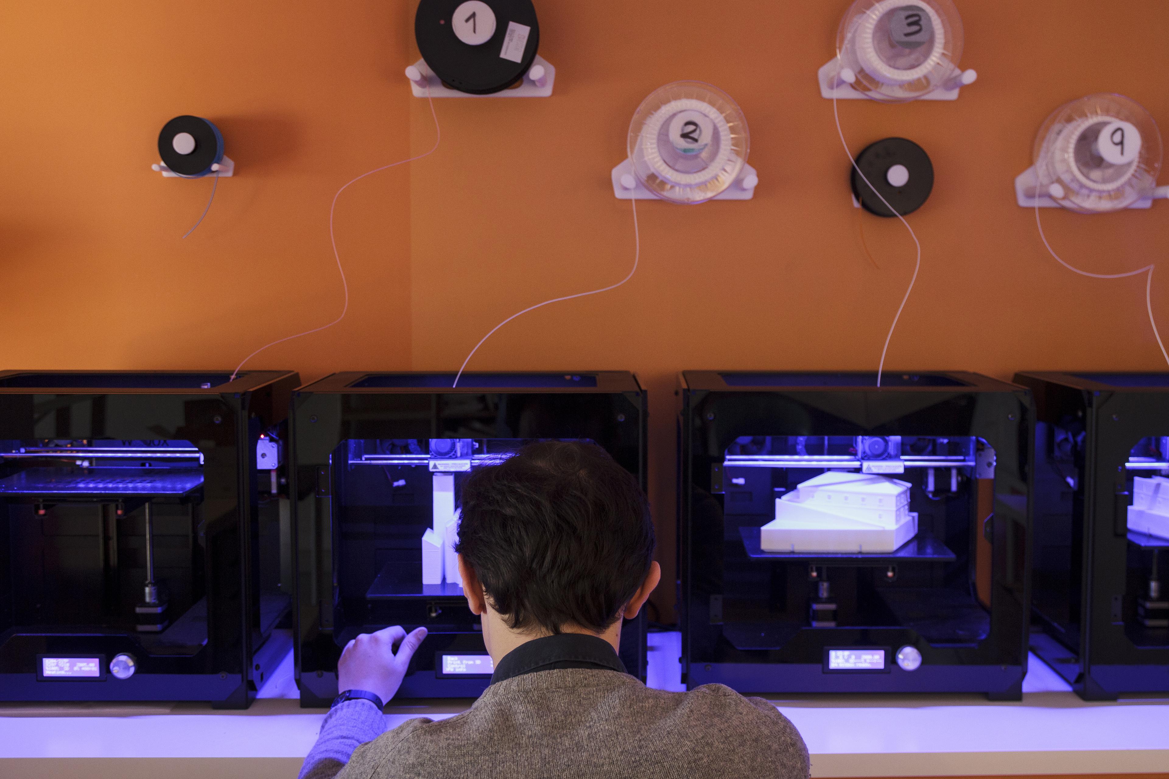 Man working 3D printers