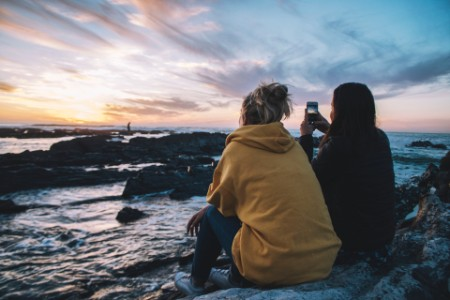 Women rocks sea sunset picture phone