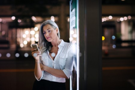 Woman with a mobile phone lights