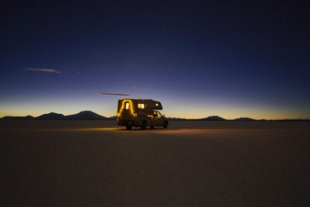Vehicle dusk salt flats Bolivia
