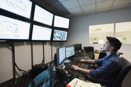 Businessman working control room