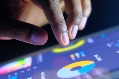 Man hands touching digital tablet business diagram