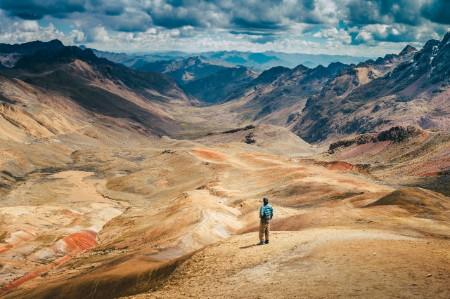 Man viewing treeless mountainside