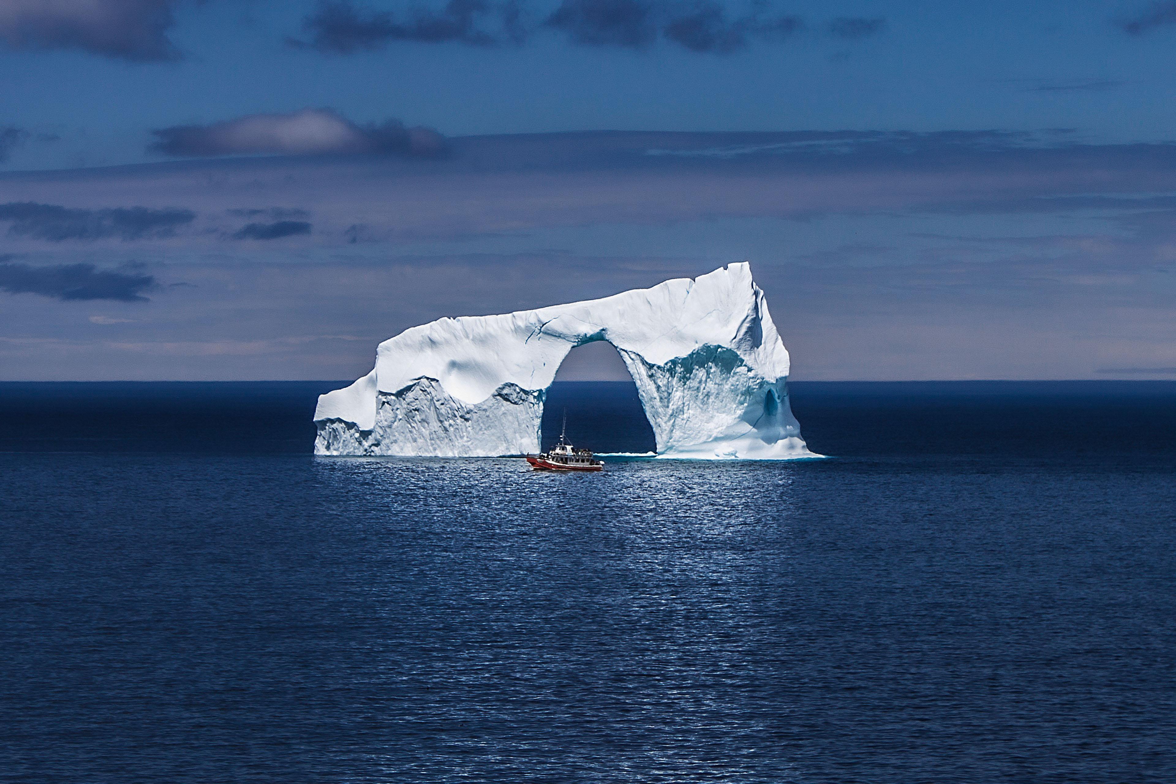 Boat sea iceberg arch image