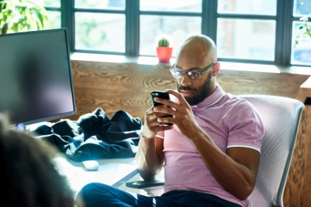 businessman on smartphone at desk